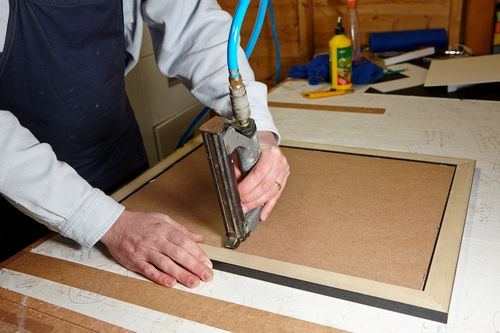 Acorn Framing - stapling backboard to frame