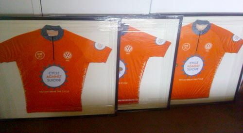 set of corporate company sponsored framed cycling jerseys
