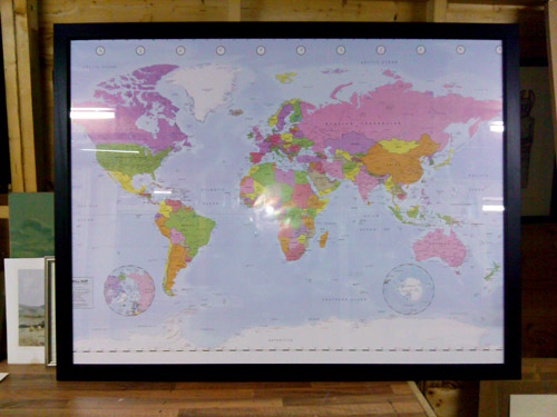 large framed map of the world