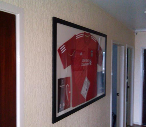 Liverpool shirt signed by Stephen Gerrard and champions league programme