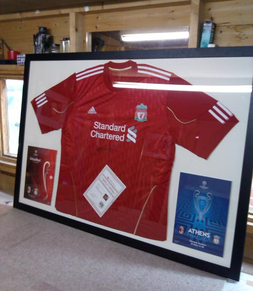 Liverpool shirt signed by Stephen Gerrard and champions league program