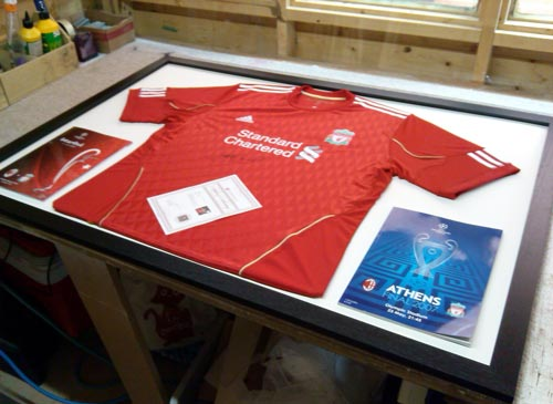Liverpool shirt signed by Stephen Gerrard and champions league programmes