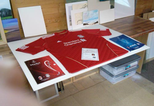 Liverpool shirt signed by Stephen Gerrard and champions league programs