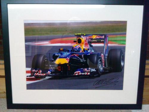 Framed signed Mark Webber in Red Bull Formula 1 car photograph